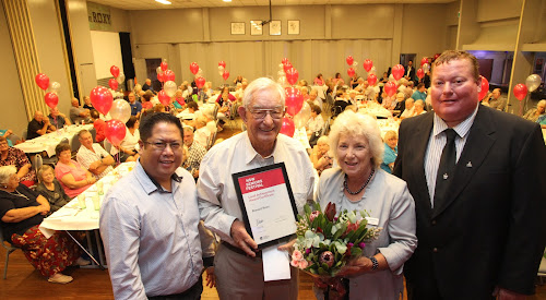 Narrabri Shire 2018  Senior of the Year Award winner Ron Rees is congratulated by Archidennis Nativida representing the Whiddon Group, Mayor Cathy Redding and Deputy Mayor Cameron Staines at the Senior's Festival luncheon at Narrabri RSL Club on Wednesday.