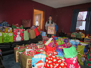 Photo: Kylee with some of the Christmas gifts for the kare kits kidz!