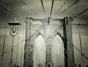 """Photo: """"Distillation process...""""  New York Photography: The Brooklyn Bridge - #MyTownTuesday  When the clouds pull their veils back from the sky's face after a storm, the light hits the world at such an angle that even the most rigid man-made creations glimmer like the water's surface in the sun.  If you could distill New York City down to an essence so pure that it glimmered in such a way, it would look like this: captured, cooled, magnificent in its indistinguishable hand-woven-steel beauty.  —-  I have been a little bit out of commission here in terms of posting due to it being the final stretch of my school semester (and university in general). Long papers and mind-crushing material I have been studying for final exams have been dominating my time. I should be back to my normal self after this week. I will be posting a bit less though.  And once again (since I have been getting many messages about where to find my photography for sale), here is the link to the master post about my photography on various posters, prints, cards, calendars and a wide variety of items - http://goo.gl/nJiKc    You can view this post if you wish at my site here:  http://nythroughthelens.com/post/14166381910/the-brooklyn-bridge-new-york-city-when-the    Tags: #photography #prose #writing #newyorkcity #newyorkphotography #photo #architecture #brooklynbridge #nyc #brooklyn #manhattan"""