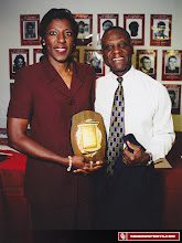 Photo: Teresa Turner with Prentice Gautt at the dedication of OU's student-athlete academic center in 1999.