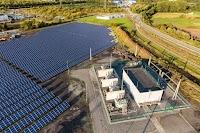 Solar panels in the green fields outside of our St. Ghislain, Belgium data center.