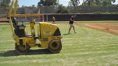 Photo: Rolling new sod 1 time.