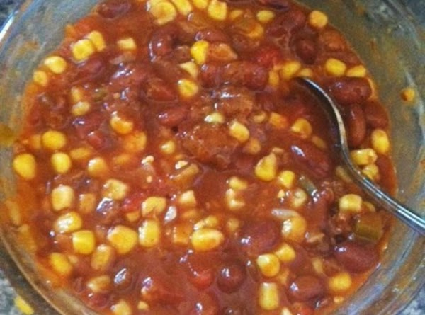 Mix the chili,salsa,and corn together. Heat in microwave on high for 2 minutes.  Spread...