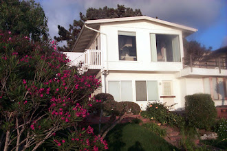 Photo: This is the house which used to be at the site - it was rather large. I really coveted that deck. I would want most of my meals there, I think. And, of course, the bougainvillea - which sort of represents Del Mar to me.   The house was removed and replaced with two smaller homes - greatly maximizing somebody's profit, I imagine.