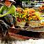 Moving Market by Chris Olivar - Food & Drink Fruits & Vegetables ( mekong river, pwcfruit-dq, floating market, rambutan, transportation )