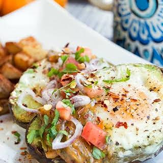 Baked Avocado Eggs with Tomato Herb Hollandaise.