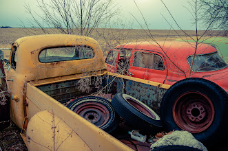 Photo: Out With The Old  I decided to play a little in Lightroom this weekend. One of the features that it has that I rarely ever use is the Split Toning sliders.  Since the trucks were old and the sky was flat I thought I might try to give the image an old 70's film feel. The easiest way I could do this would be to apply one of the presets that I've collected over the years. But I decided I wanted to get the effect on my own and create my own preset. After quite a few iterations of color combinations I landed on this one. A touch of green to the highlights and a pinch of purple to the shadows and this is what resulted.  #splittone #classiccars