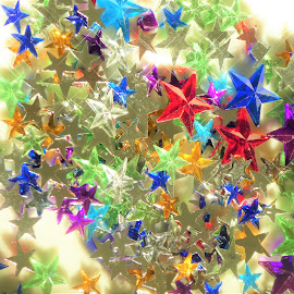 A close up on star shaped colourful crystals in a light by Svetlana Saenkova - Artistic Objects Glass ( glass, bright, glitter, colourful, stars, many, sparkling )