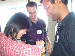 Photo: Nancy, Elchanan, and Sourav attempt to open bottle (no success)