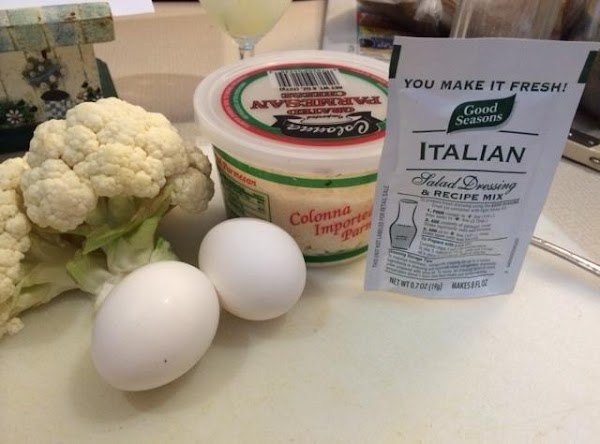 Next, combine cauliflower, italian dressing mix, eggs, and parmesan cheese, and mix well.