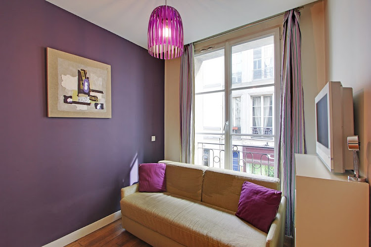 Living area at Studio Apartment on Rue Du Temple