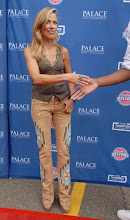 Photo: CLARKSTON, MI - AUGUST 12: Sheryl Crow greets a member of the Detroit Pistons at the Palace Sports and Entertainment's Come Together Celebration concert at the DTE Energy Music Theater on August 12, 2012 in Clarkston, Michigan. (Photo by Paul Warner/Getty Images)