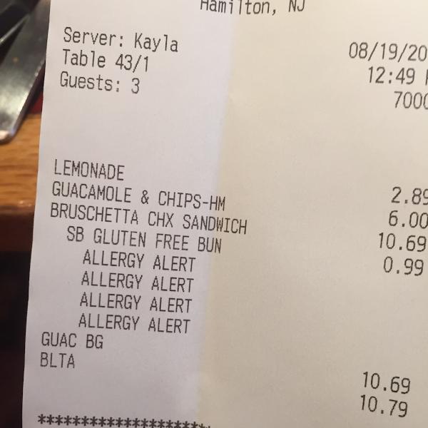 Receipt written allergy alert to warn the chef