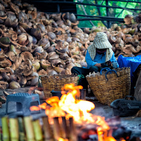 Worker by Phattana Sangsawang - People Street & Candids ( cuisine, thailand, thai, taste, heat, people, hat, farmer, barn, dessert, work, fat, agriculture, job, coconut shell, row, country, tasty, sweet, dress, food, eat, burn, natural, make, culture, bamboo, coconut, simple, one, hand, life, tradition, asia, worker, lam, cooking, hard, rice, delicious, snack, fire, farming, field, labor, organic, sticky, outdoor, scenery )