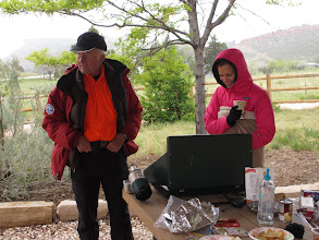 Photo: Dick of Larimer County Search and Rescue and Lisa keeping things warmed up.