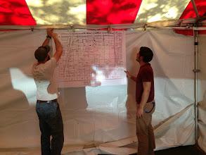 Photo: PPR Volunteer Coordinator Jason Mifflin and VISTA Charles Bouril set up the medical tent