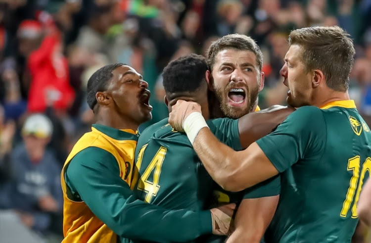 Team mates congratulate Willie le Roux of South Africa after his try during the 2018 Castle Lager Incoming Series match between South Africa and England at Emirates Airline Park on June 09, 2018 in Johannesburg, South Africa.