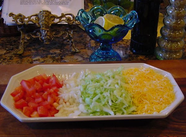 BUILD THE TACOS: Place the meat in the cooked taco shell and top with lettuce,...
