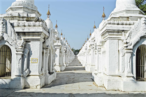 Myanmar-colonnade - Stunning white temple with inscribed Sanskrit texts.