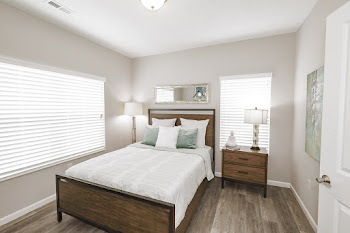 Daphne floorplan bedroom with wood-inspired flooring