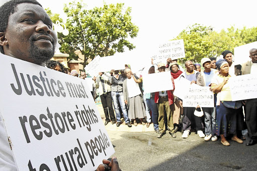 Eastern Cape residents protest at a land claims case. There is a common understanding that SA's land reform process has been too slow, bureaucratic and costly, say the writers. Picture: YANDISA MONAKALI