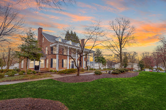 Clubhouse with red brick and large porch at dusk
