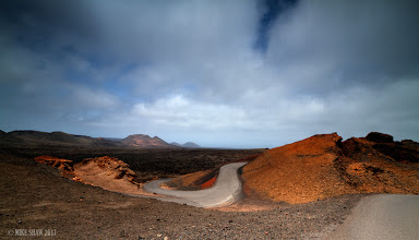 Photo: Twist And Turn. Part of the fire mountain reserve on Lanzarote, I just loved the twist on the road. I was a little dissapointed as there is not a lot to inspire you here. The landscape has been turned almost to desert after the volcanic eruptions in the 1800's. Its a very arid country that is still trying to recover after all these years.
