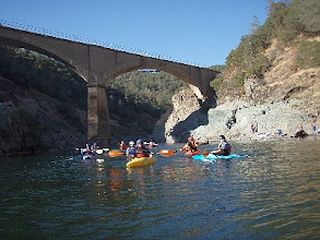 Photo: Mob of kayakers heading downstream.