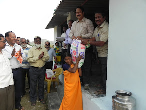 Photo: Distribution of free rice to inmates of Kapparamajji