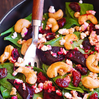 Beet Salad with Spinach, Cashews, and Goat Cheese.