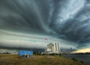 """Photo: The proper way to do attribution at a bare minimum, Mashable (and all you other lazy bloggers), is to do this:  """"Photo by Trey Ratcliff from StuckInCustoms.com [linked]"""".  Simple.  Now, as for this photo in particular, in case you were a'wonderin', this is a giant storm hitting the NASA vehicle assembly building.  To give you a sense of scale, inside that building they built the entire Saturn V rocket that went to the moon..."""