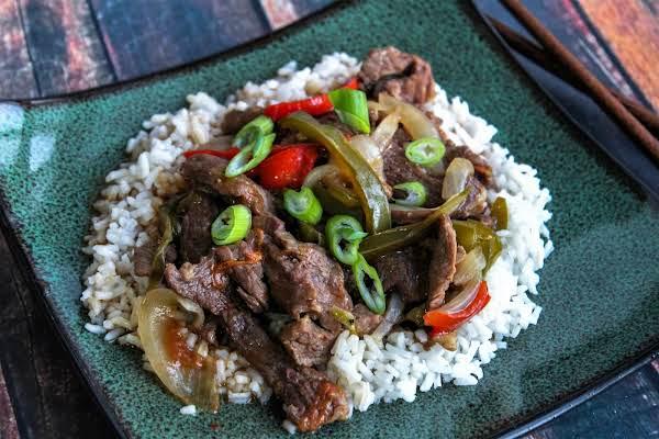 Pepper Steak Served Over Rice.