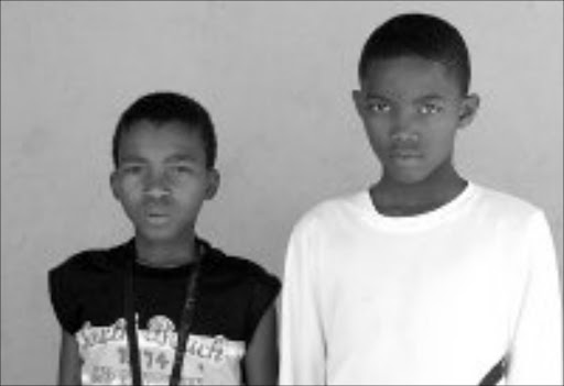 IN MOURNING: Mpho and Fana cannot stop crying for their friend who was run over by a car. Pic. Mohau Mofokeng. 06/09/2007. © Sowetan.