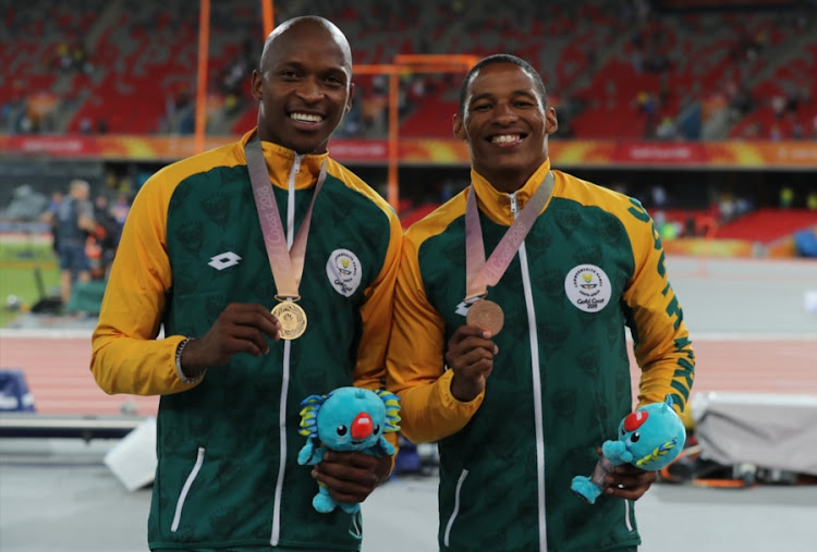 Luvo Manyonga and Ruswahl Samaai of South Africa during the Medal Ceremony of the Men's Long Jump Final on day 7 of the Gold Coast 2018 Commonwealth Games at Carrara Stadium Track on April 11, 2018 in Gold Coast, Australia. Manyonga won gold while Sammai bagged bronze.