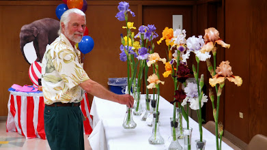Photo: David places one of the blue-ribbon entries on the Table of Consideration.
