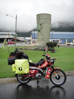 Motorbike parked in front of The Big Golden Gumboot