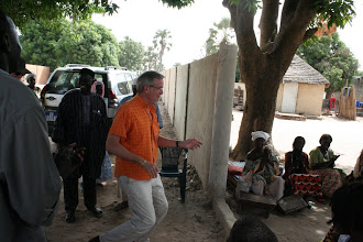 Photo: Dr. Dudley on a Faculty Development trip to Senegal 2010 - he got off the bus dancing.