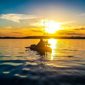 Paddling In by Mitch Lassiter - Landscapes Sunsets & Sunrises ( sunset, lake, kayak, north carolina )