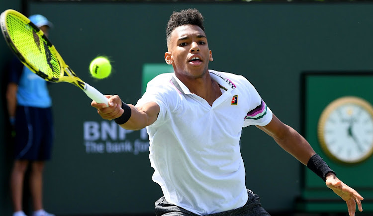 Canadian Felix Auger-Aliassime on his way to defetaing Stefanos Tsitsipas in their second round match in the BNP Paribas Open at the Indian Wells Tennis Garden on Sunday, March 10