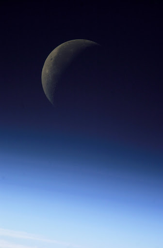 View of the Crescent Moon / moonset taken during Expedition 8