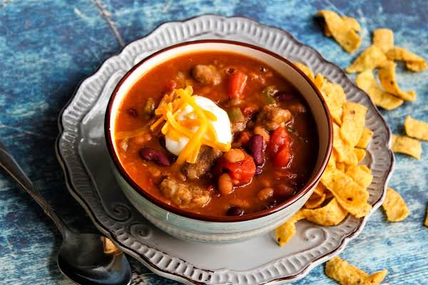 Steak Chili With Sour Cream And Cheddar Cheese On Top.