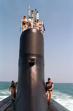Photo: 970703-N-6483G-025 At sea aboard USS Seawolf (SSN 21) Jul. 3, 1997 -- Crew members move Òtop-sideÓ to make final preparations for arrival pier side in Port Canaveral, FL. Seawolf was submerged for 3 days during her most recent sea trial from the submarine base in Croton, CT. U.S. Navy Photo by Chief Photographer's Mate John E. Gay (RELEASED).