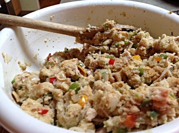 Add the stuffing and croutons to a large bowl, then pour in the cooked...