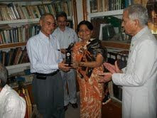Photo: Prof. Zakia Siddiqi presenting memento on WHD to Prof S. Abrar Hasan (Dean, Faculty of Medicine, JN Medical College, Aligarh)