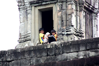 Photo: Year 2 Day 44 -  Local Kids Sat in One of the Towers of Phnom Bakheng