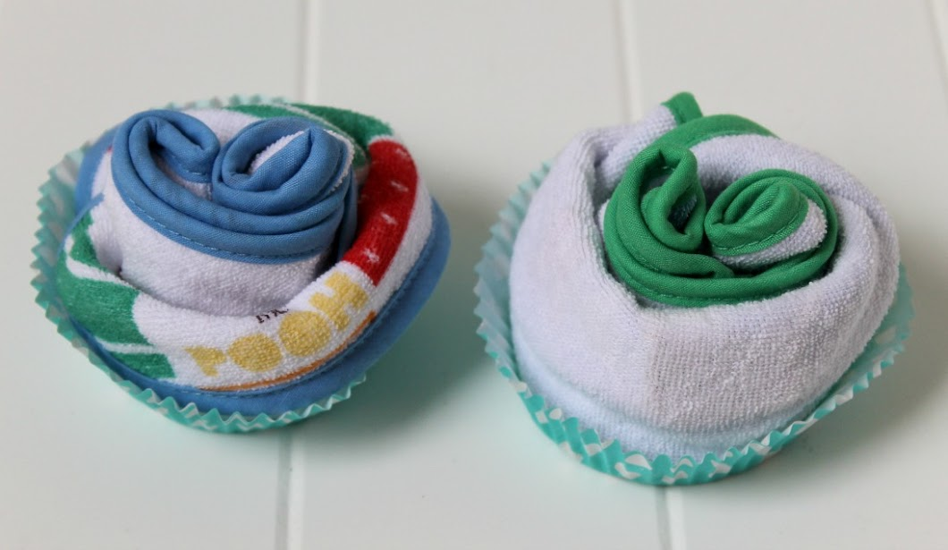 "Lastly fold down the top and tuck into cupcake liners for easy Disney Baby ""Cupcakes"" DIY baby shower gifts!"