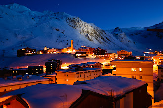 Photo: Night falls over Tignes ski resort in the French Alps.
