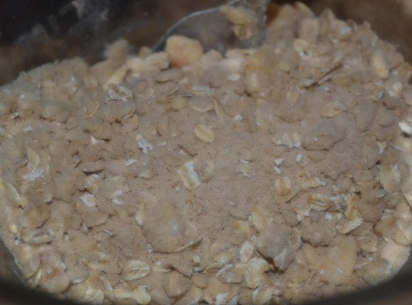 For the topping and crust:   In a large bowl, combine the oats,...