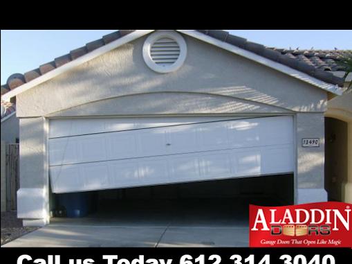 Garage door off track in maple grove mn aladdin garage for Garage door repair elgin il