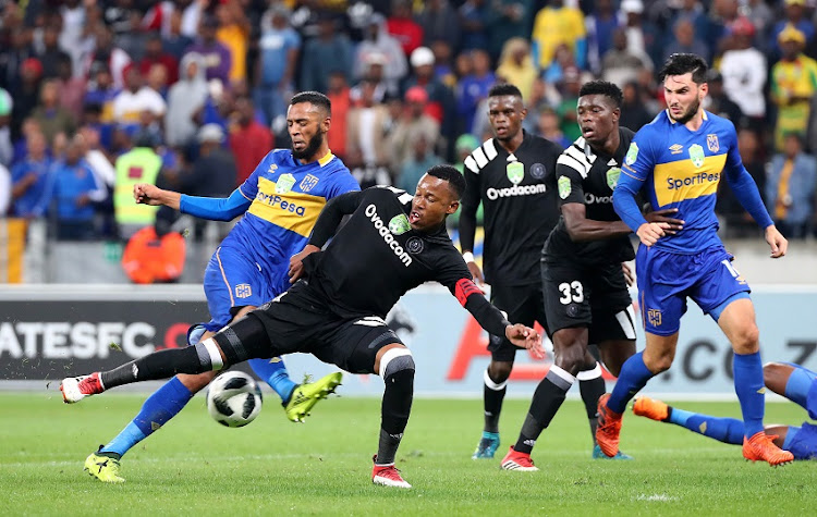 Happy Jele of Orlando Pirates challenged by Roland Putsche of Cape Town City during the 2018 Nedbank Cup Last 16 football Match between Cape Town City FC and Orlando Pirates at Cape Town Stadium in Cape Town on 14 March 2018.